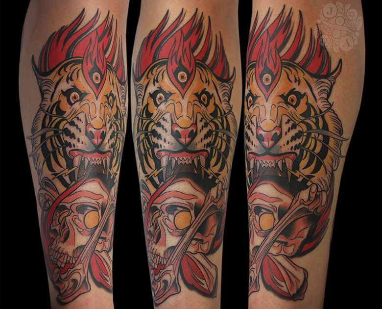 neotraditional flaming three eyed tiger biting skull and bones
