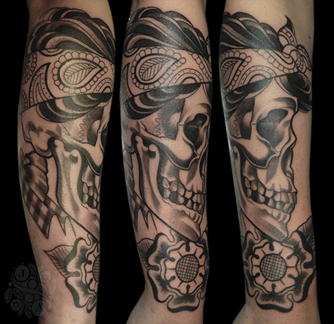 black sideview skull with bandana and flowers tattoo by Justin Acca